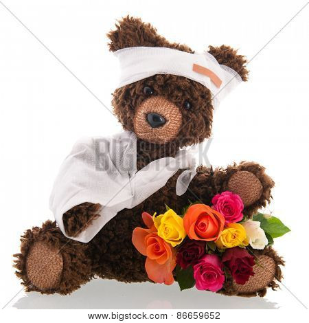 Stuffed hand made poorly bear with plaster and flowers for