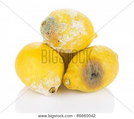 Heap of decayed lemon isolated on white background