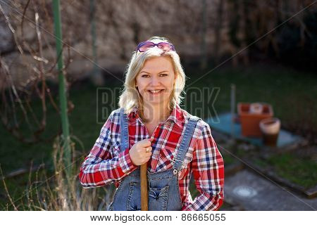 Blonde Woman In Flannel Shirt And Glasses Outdoor Works