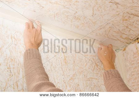 Female hands glued paper tape