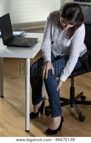 Businesswoman Having Leg Swelling
