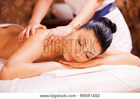 Relaxing In Hands Of Experienced Therapist.
