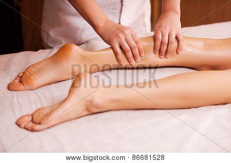 Massaging Tired Legs.