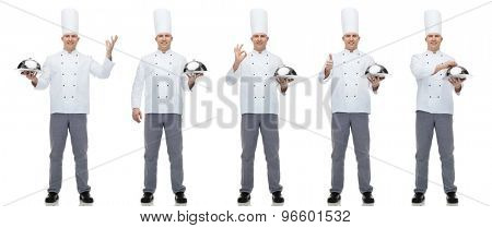 cooking, profession and people concept - happy male chef cook holding cloche poster