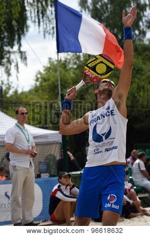 MOSCOW, RUSSIA - JULY 19, 2015: Regis Courtois of France in action during the ITF Beach Tennis World Team Championship. 28 nations compete in the event this year