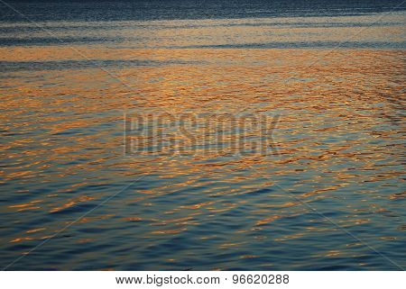 Sunset Reflection on the Surface of a Calm Sea