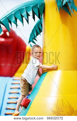 Little Cool Boy Have Fun On An Inflatable Trampoline