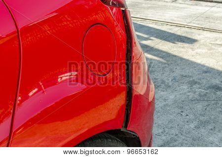 Red Car Damage At Rear Skirt