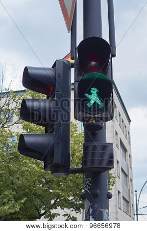BERLIN, GERMANY - JULY 08: Detail of pedestrian traffic light showing emblematic Berlin green man. July 08, 2015 in Berlin.