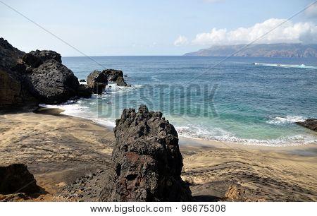 Pointy Rock On A Beach In Djeu
