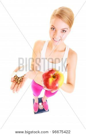 Woman Holding Vitamins And Apple. Health Care.