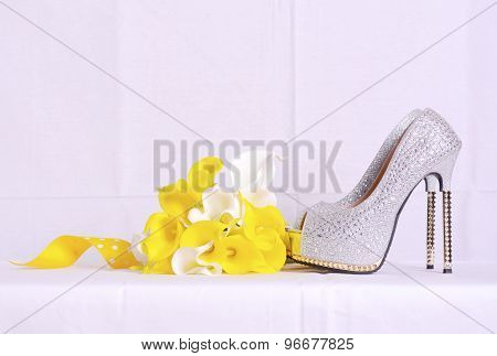 Wedding Shoes And Bouquet In Natural Setting.