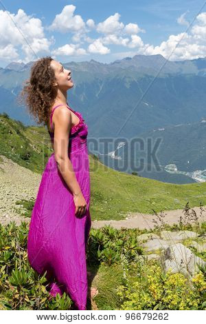 woman in evening dress in the mountains