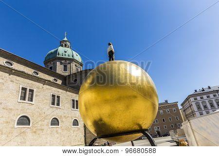 Artwork Of Stephan Balkenhol, Man On The Golden Ball At The Residenzplatz
