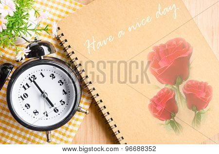 Text Have A Nice Day On Brown Diary And Clock.