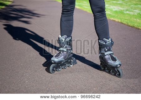 Close Up View Of Legs In Roller Blades