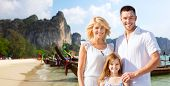 summer holidays, travel, tourism, children and people concept - happy family over beach in thailand or bali background poster
