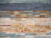 wall background made from small colorful stone bricks poster