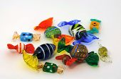 Dozen of multi-colored Venetian glass candy on white background. poster