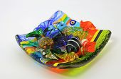 Multi-colored Venetian glass candy are on colored glass Venetian dish. poster