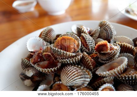 a dish of parboiled cockle shells on table