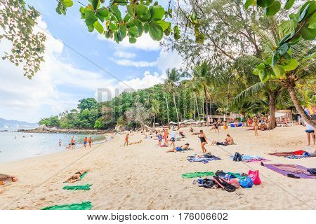 PHUKET THAILAND - JANUARY 222017: The unidentified people are relaxing on Paradise beach during a sunny day in Phuket Thailand. Patong is one of famous beach located in the west coast of Phuket