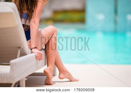 Young woman sunbathing on lounger. Close up.