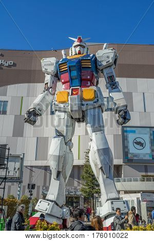 ODAIBA - TOKYO, JAPAN - 17 February 2017: Statue of Gundam at DivercCity Tokyo Plaza in Tokyo. It is ratio 1:1 of Gundam Statue Performances a the biggest Gundam in the world.