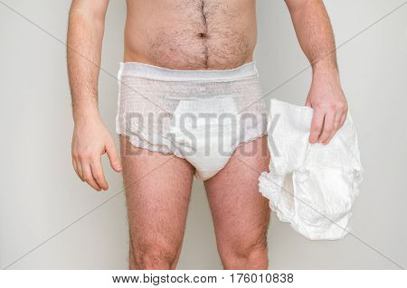Man wearing incontinence diaper isolated on white