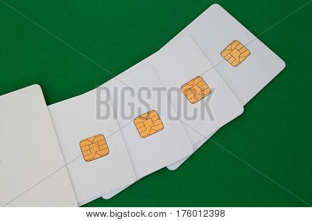 Group of credit card on the green desk. Bussines and finance.