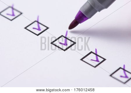 Checkbox with purple tick. Evaluation. Business concept