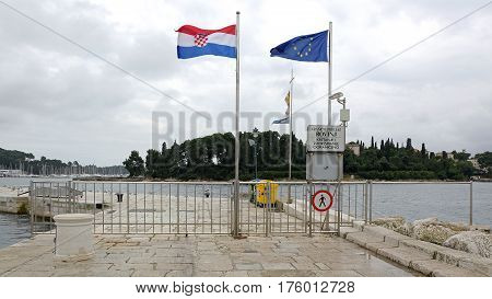ROVINJ CROATIA - OCTOBER 15: Water Border Crossing in Rovinj on OCTOBER 15 2014. Port Dock With Border Line in Rovinj Croatia.