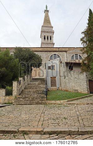 ROVINJ CROATIA - OCTOBER 15: St. Euphemia Cathedral in Rovinj on OCTOBER 15 2014. Church and Tower Landmark in Rovinj Croatia.