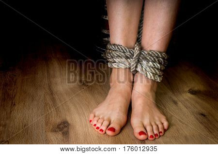 Feet Of A Victim Woman Tied Up With Rope