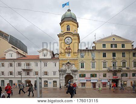 RIJEKA CROATIA - OCTOBER 17: Clock tower and CIty Gate in Rijeka on OCTOBER 17 2014. Landmark Tower at Korzo Pedestrian Street in Downtown Rijeka Croatia.
