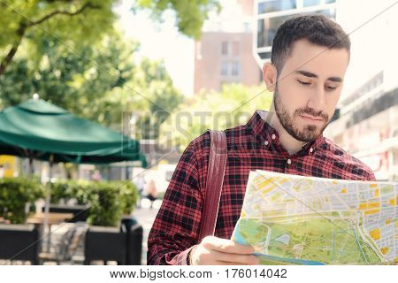 Young Tourist Man Looking At A Map.