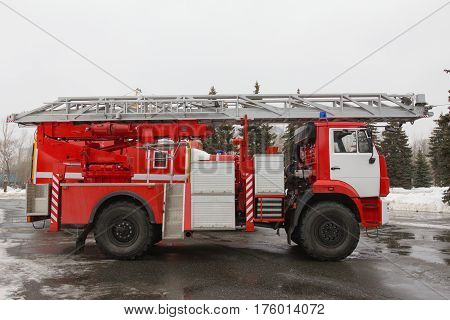 Fire truck with ladders and hoses - big red Russian fire fighting vehicle, horizontal