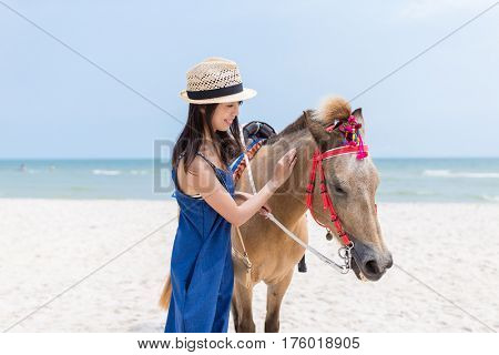 Woman caress on horse