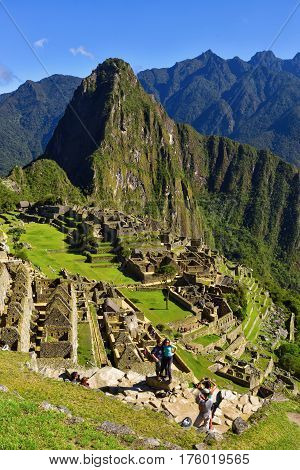 Machu Picchu Peru - 13 Oct 2016: View of the Lost Incan City of Machu Picchu near Cusco Peru. Machu Picchu is a Peruvian Historical Sanctuary. People can be seen on foreground.