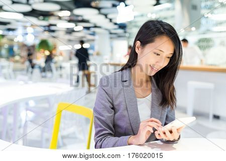 Businesswoman working on her cellphone