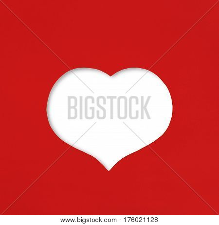 Heart shaped cut on red paper with white blank as Valentines Day symbol