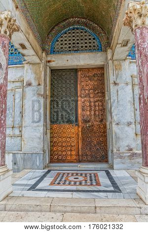 One of the copper doors at an entrance to the shrine Dome of the Rock, an Islamic shrine located on the Temple Mount in the old city Jerusalem, Israel.