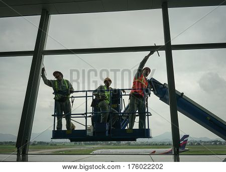 Workers Of Steeplejack Washing Windows