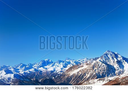 Panoramic view of beautiful snowcapped mountain peaks at sunny day