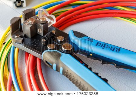 Wire stripper and cutter with colored wires poster