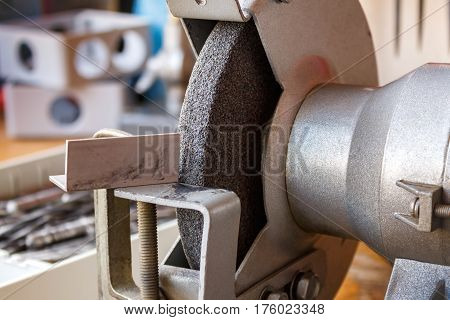 Grinding machine on the table in the workshop closeup
