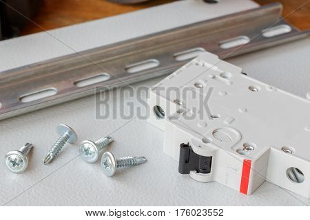 DIN rail circuit breaker and the screws on the mounting plate