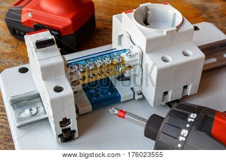 Circuit breaker with wire terminal block and electric socket on the DIN rail