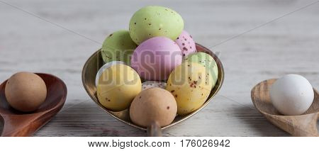Easter Eggs - Speckled And Sugar Coated On Wooden And Silver Spoons On White Rustic Wooden Table. Cl