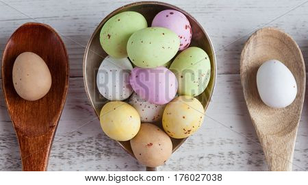Easter Eggs - Speckled And Sugar Coated On Wooden And Silver Spoons On White Rustic Wooden Table, To